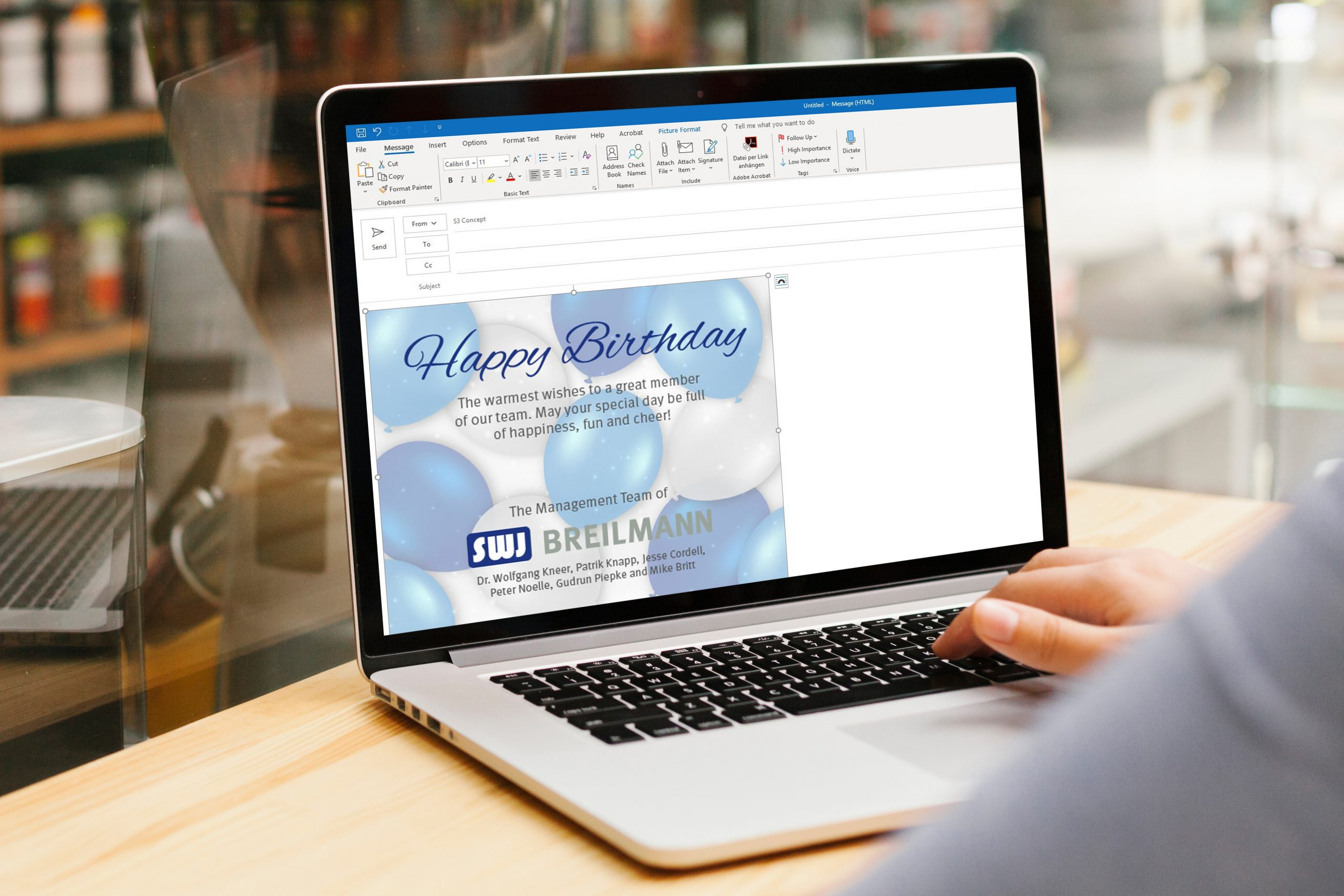 birthday email on laptop screen on desk
