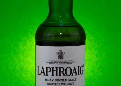 green whisky bottle on green background