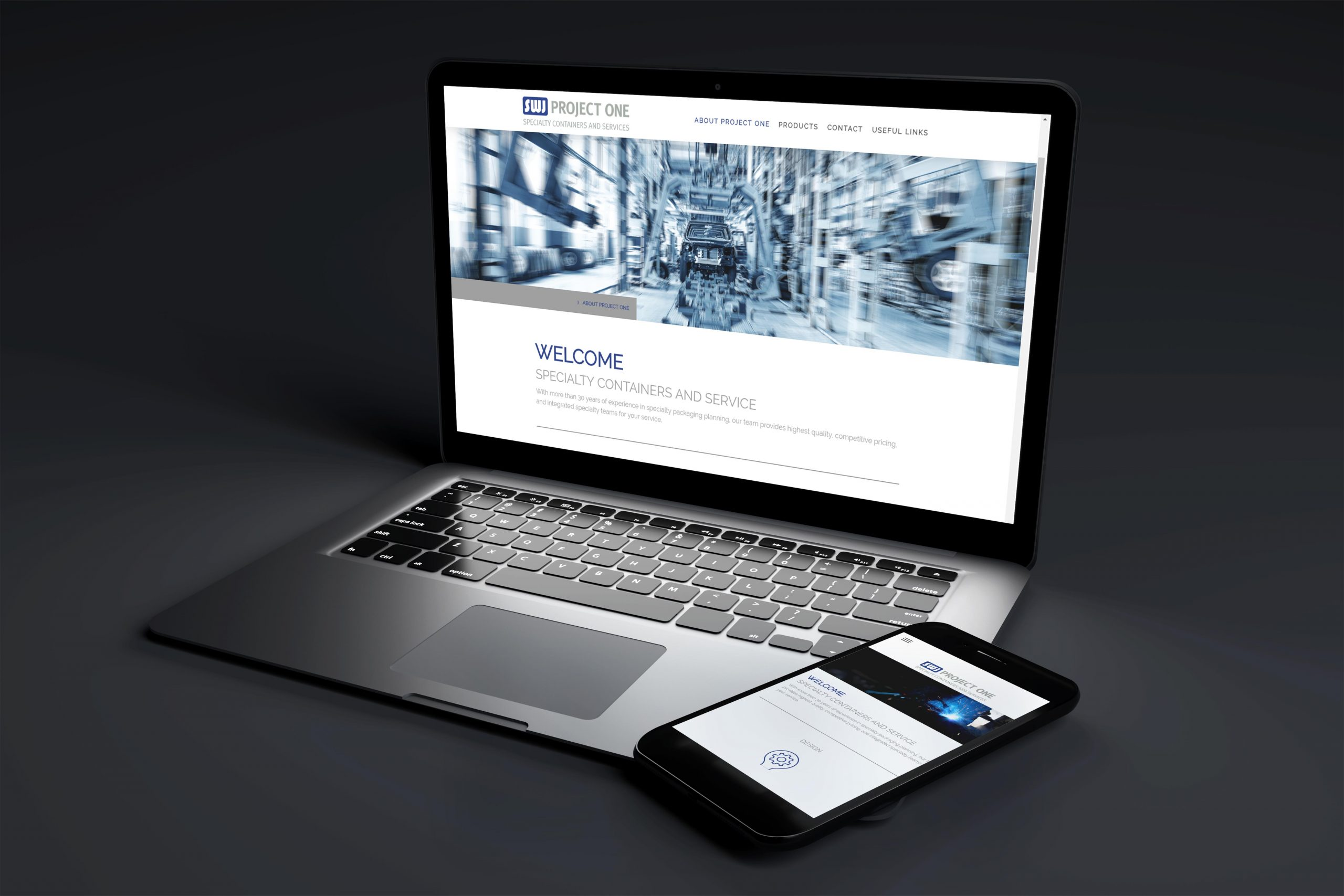 laptop and cell phone on black background webdesign