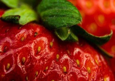 macro photography of strawberries on black background