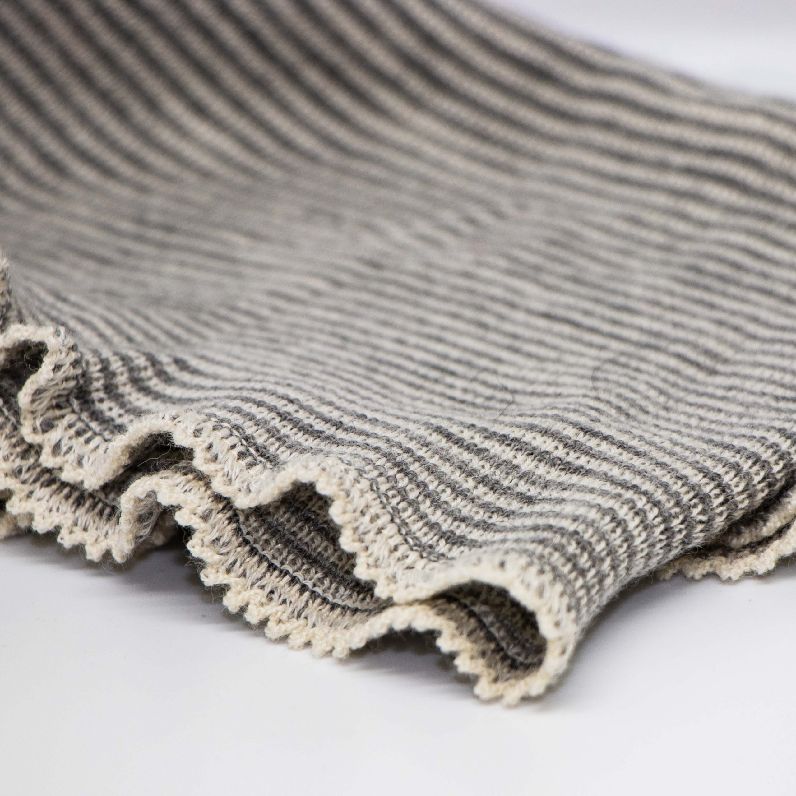 white and grey striped wool baby blanket