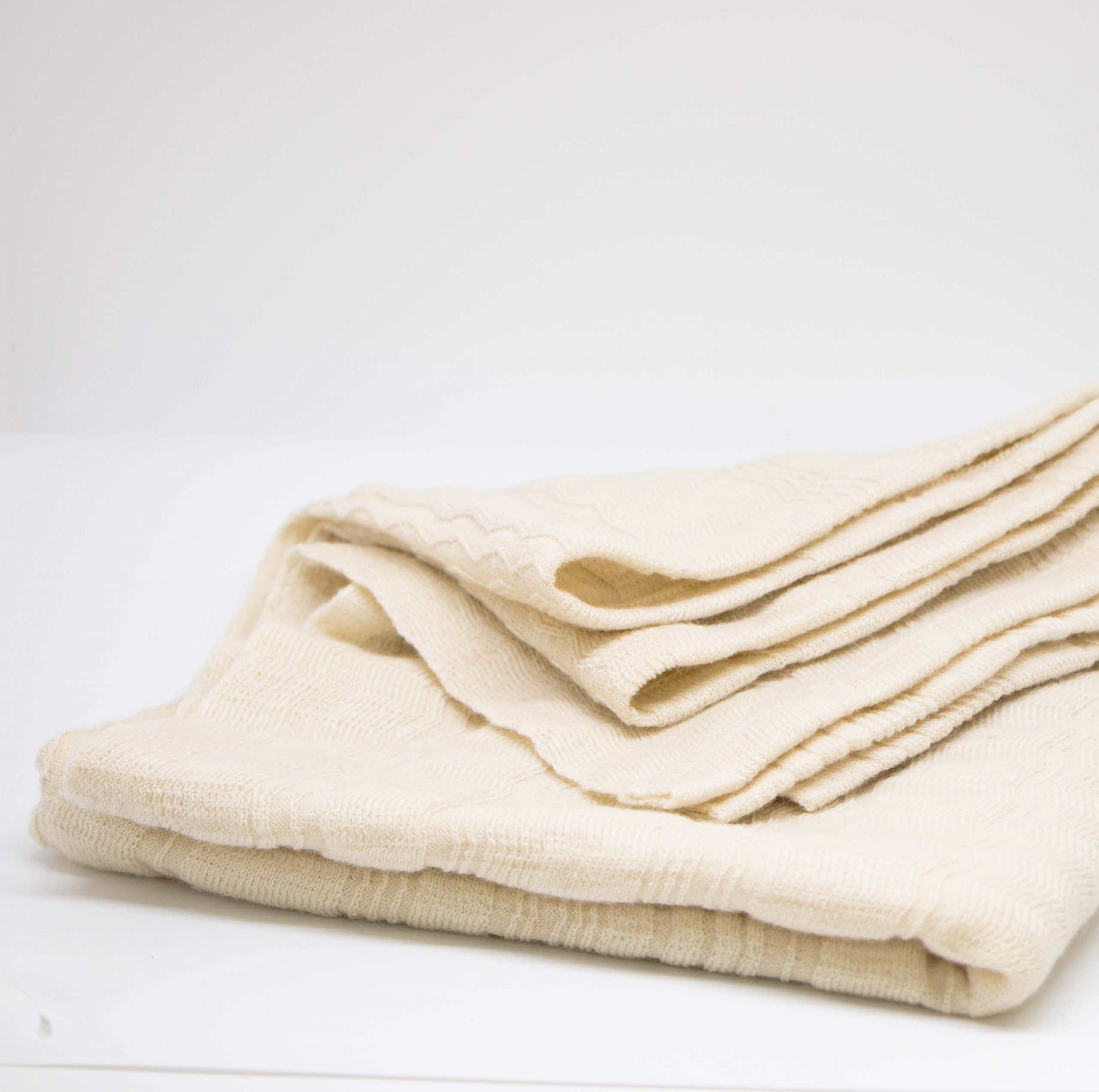 white wool blanket for babies on white background