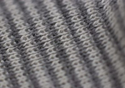 macro photography of wool blanket grey and white