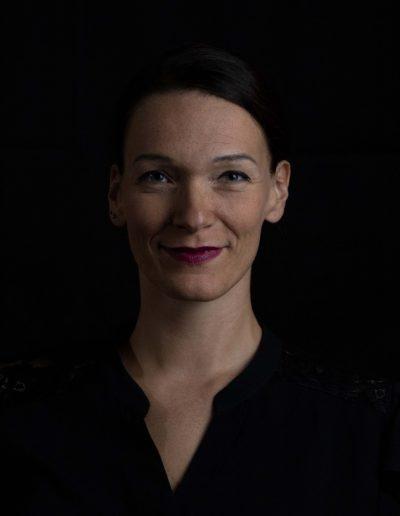 woman business portrait black background