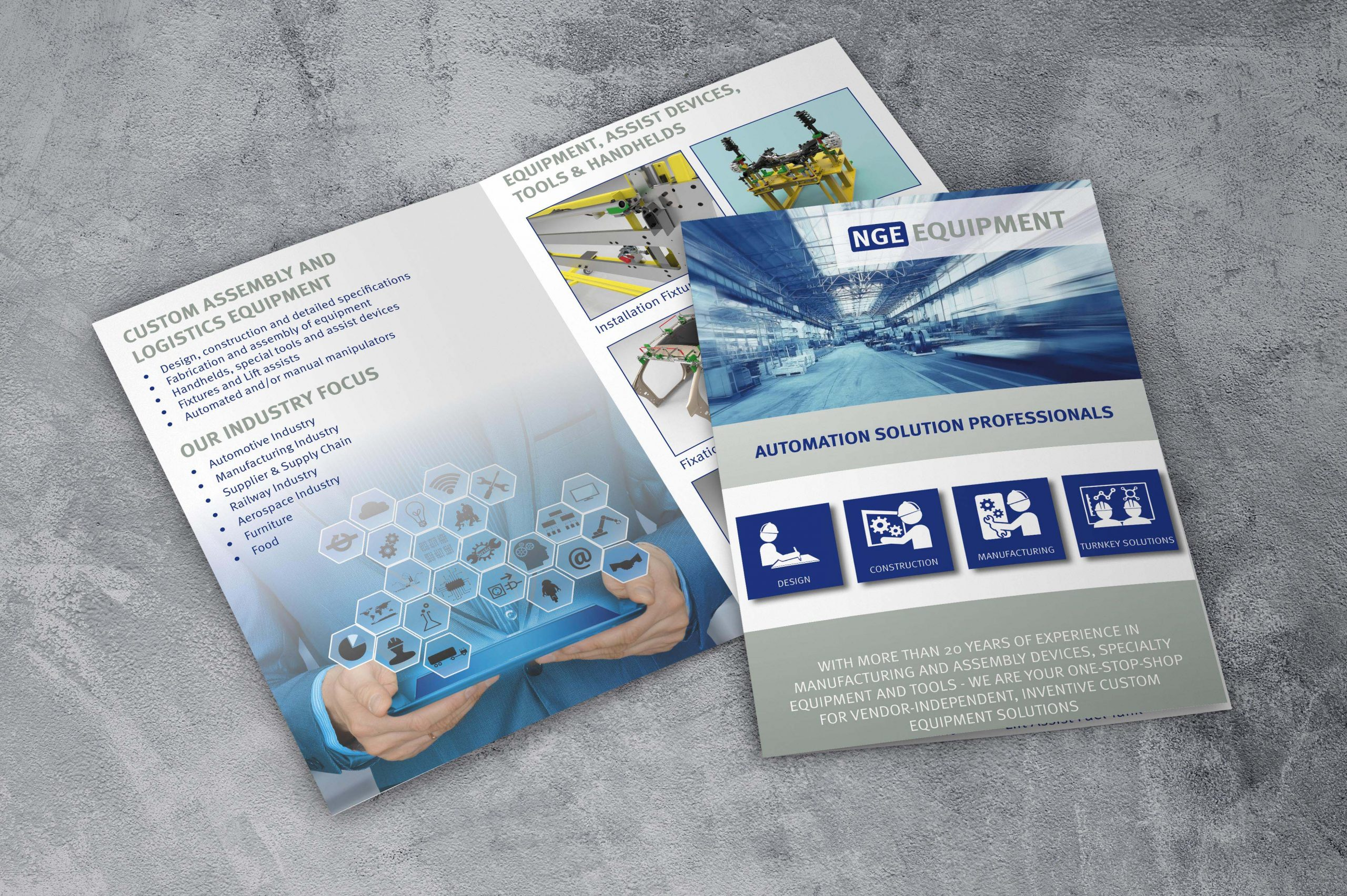 flyer with 4 pages lying on concrete floor