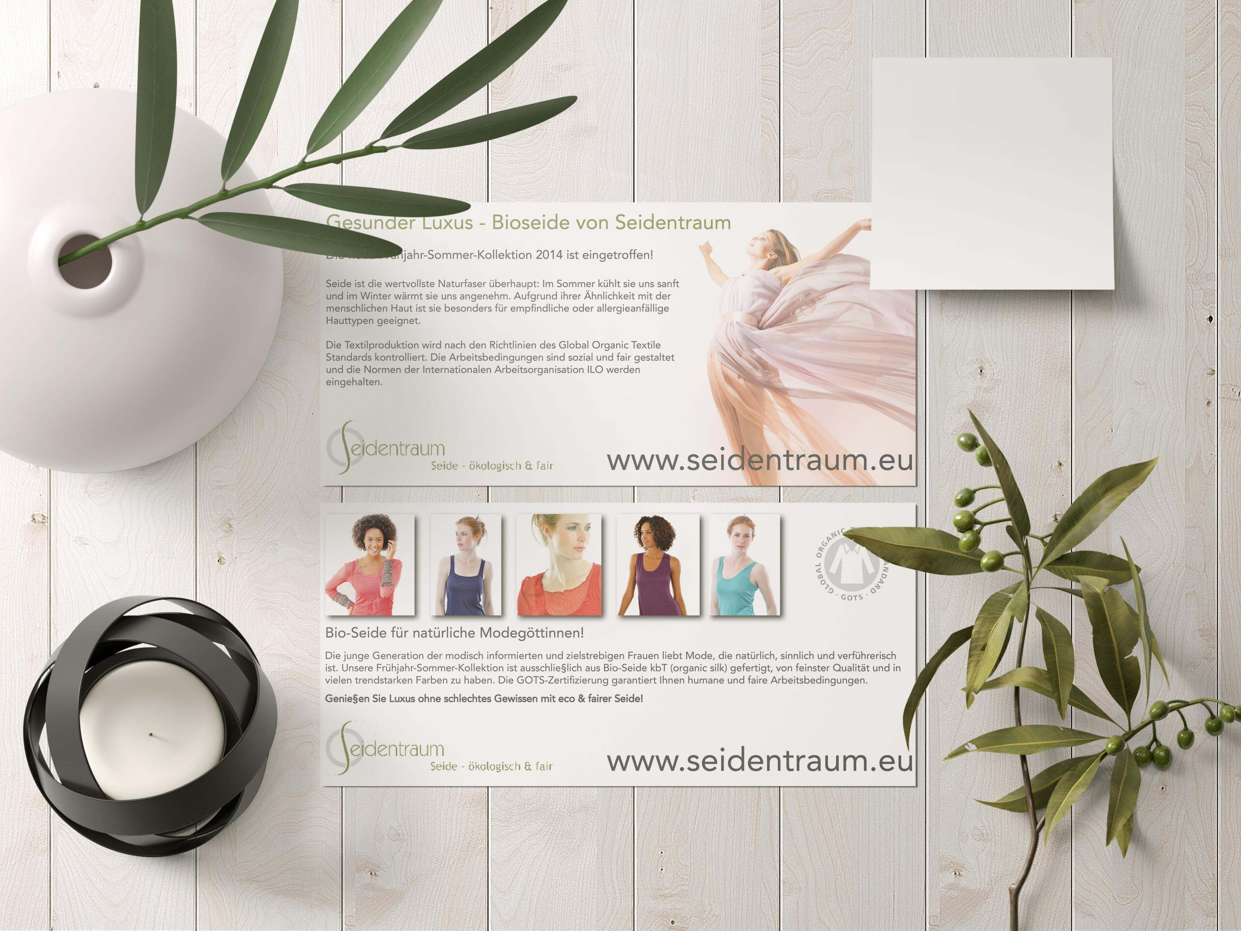 flyer lying on white wooden background with vase and branch