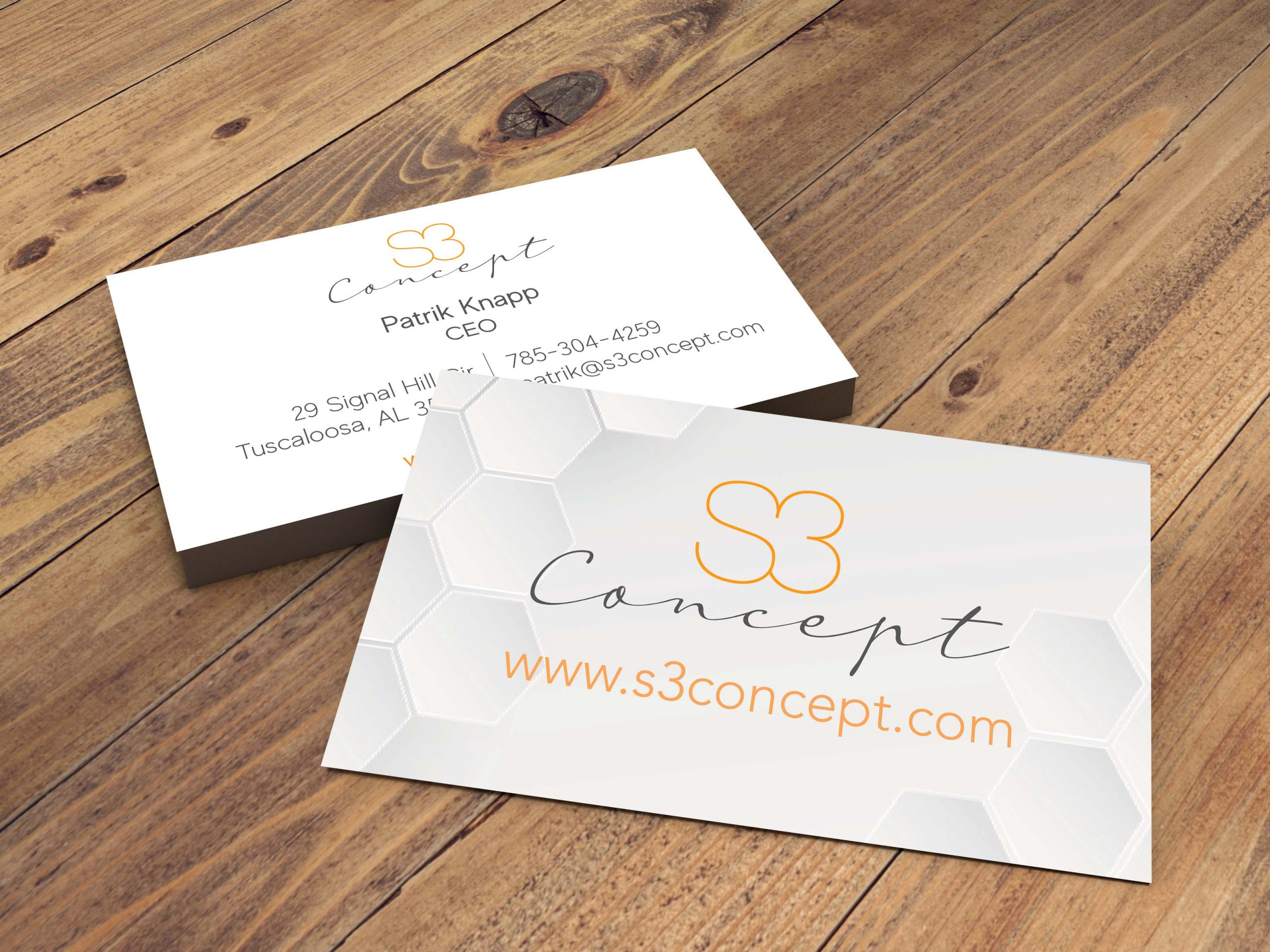 business card on wooden floor
