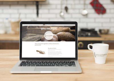 website design on laptop and customized mug with logo