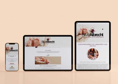 website design on laptop and mobile screens